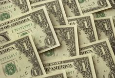 One dollar bills lying on one another stock photos