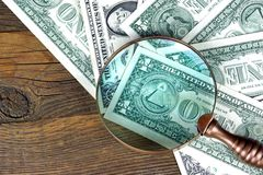 One Dollar Bills Under Vintage Magnifier Glass Stock Photography