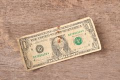 One dollar bills on a wooden background. Stock Images