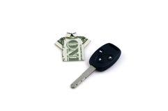 One dollar and car key. One dollar like tshirt and car key as symbol of success royalty free stock photo