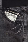 One dollar cash in jeans pocket Royalty Free Stock Images