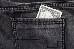 One dollar cash in jeans pocket Stock Photography