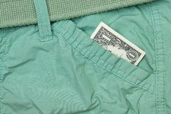 One dollar cash in pants pocket. Close up Stock Photography