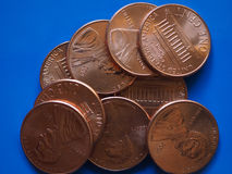 One Dollar Cent USD coin, United States USA over blue Royalty Free Stock Images