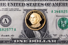 One dollar coin - George Washington - on one dollar banknote Royalty Free Stock Image