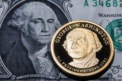 One dollar coin - George Washington - on one dollar banknote Stock Photo
