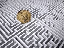 One dollar coin in the labyrinth maze Stock Photo