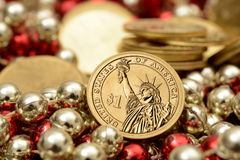 One Dollar coin with pile of golden coins.  Royalty Free Stock Photography