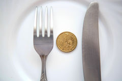 One dollar coin on a white plate Royalty Free Stock Photo