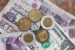 One dollar with egyptian money Royalty Free Stock Image