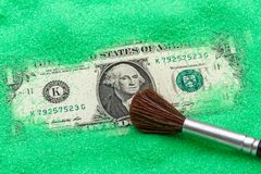 One dollar in green sand Stock Photo