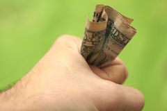 One dollar in the hand Stock Photo