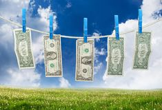 One Dollar Hanging on Rope Stock Photos