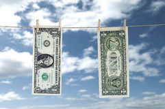 One Dollar Hanging a Rope with Clothespin Royalty Free Stock Photos