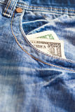 One dollar in jeans Royalty Free Stock Photo