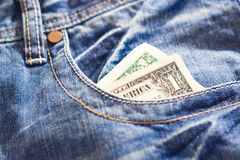 One dollar in jeans Royalty Free Stock Photos