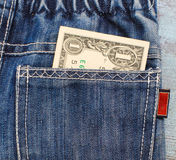 One dollar in a jeans back pocket Stock Images