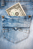 One dollar in the  jeans pocket. Royalty Free Stock Photos