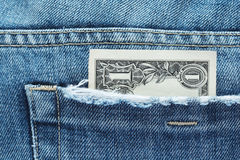 One dollar in a jeans pocket Stock Photo