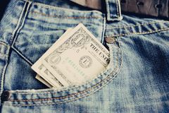 One dollar in the jeans pocket. One dollar banknotes in the jeans pocket Royalty Free Stock Photography