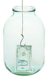 One dollar money and fishhook in glass jar Royalty Free Stock Images
