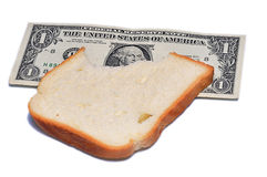 One dollar near bread Royalty Free Stock Photography