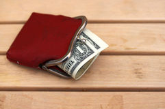 One-dollar notes in an old red purse Royalty Free Stock Images