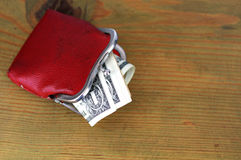 One-dollar notes in an old red purse Royalty Free Stock Photo
