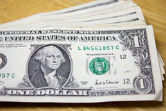One dollar on a table Royalty Free Stock Photo