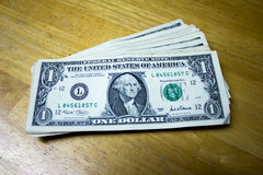 One dollar on a table Stock Photography