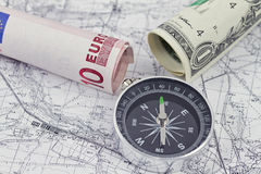 One-dollar, ten Euro bills and a compass Stock Image