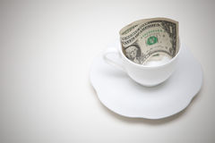 One dollars money in coffee cup Royalty Free Stock Photos