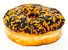 One doughnut. A closeup of   a single ring donut with Halloween sprinkles Stock Images