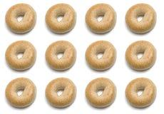 One Dozen Bagels. One dozen whole wheat bagel isolated on white Stock Image