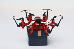 One drone with package box Stock Images