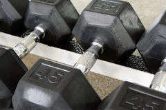 One Dumbbell. Is shown on the dumbbell rack royalty free stock photography