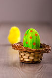 One Easter egg in a basket Stock Photo