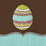 One easter egg over  brown background Royalty Free Stock Image