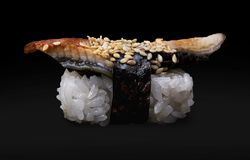One Eel Sushi. On a black background royalty free stock photography
