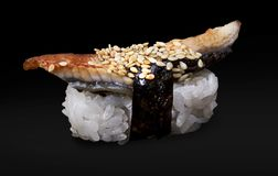 One Eel Sushi. On a black background royalty free stock image