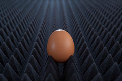 One egg on abstract bumpy black background with perspective Royalty Free Stock Photography