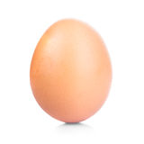 One egg. Beige egg isolated on a white background royalty free stock photography