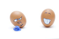 One egg laughs at other Royalty Free Stock Photos
