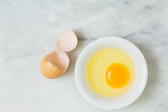 Free One Egg Yolk In White Bowl Stock Images - 56359004