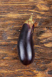 One eggplant on a wooden table Stock Photography