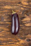 One eggplant on a wooden table Stock Photos