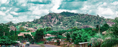 One of the Ekiti Hills in Ikere Ekiti Nigeria. One of the many rocks and hills in Ekiti State of Nigeria Africa. There is visible housing development at the Stock Photo