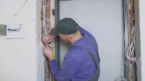One electrician at work laying wiring cable.  stock footage