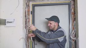 One electrician at work laying wiring cable.  stock video footage
