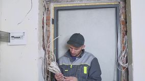 One electrician at work laying wiring cable.  stock video